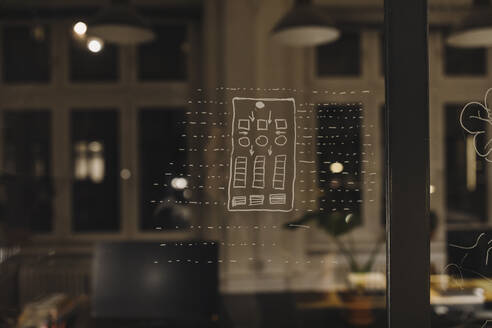 Drawing at a glass pane in office - GUSF02757