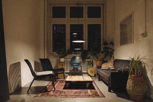 Lounge room in an office at night - GUSF02760