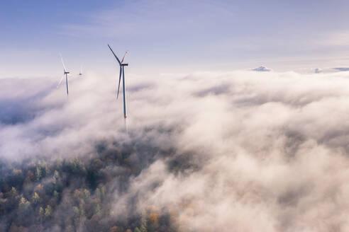 Germany, Baden-Wurttemberg, Goldboden, Wind farm shrouded in autumn fog - STSF02364