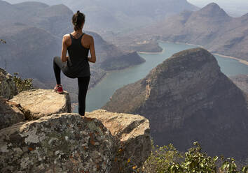 Woman on the top of a rock at Blyde River Canyon, South Africa - VEGF00863
