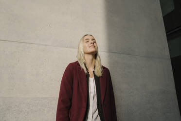 Portrait of blond businesswoman with closed eyes - AHSF01365