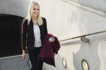 Blond businesswoman going out from metro station - AHSF01386
