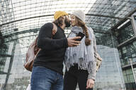 Young couple kissing at the central station, Berlin, Germany - AHSF01417