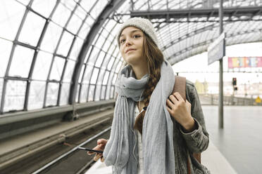 Young woman waiting at the station platform, Berlin, Germany - AHSF01426