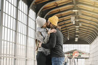 Young couple kissing at a subway station, Berlin, Germany - AHSF01498