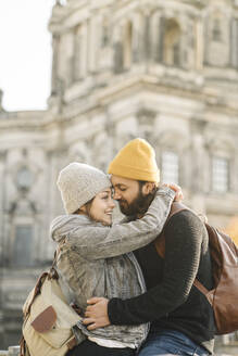 Happy young couple embracing with Berlin Cathedral in background, Berlin, Germany - AHSF01513
