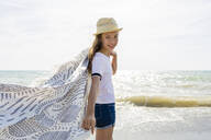 Smiling girl with towel on the beach, Tuscany, Italy - OJF00357