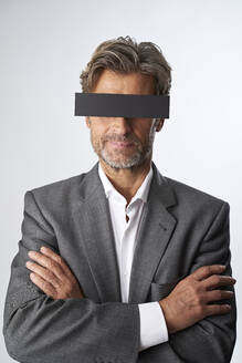 Portrait of mature man with censorship bar - PHDF00015