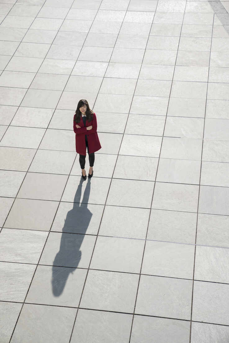 View from above of walking modern businesswoman standing on concrete floor - AHSF01543 - Hernandez and Sorokina/Westend61