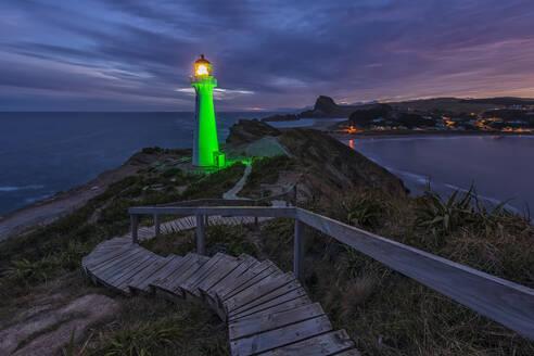Illuminated lighthouse at dusk, Castlepoint, New Zealand - FOF11252