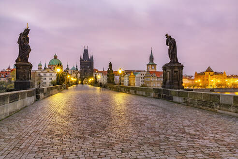 Czech Republic, Prague, Illuminated Charles Bridge at dawn - YRF00216