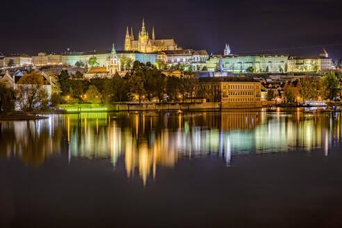 Czech Republic, Prague, Vltava river, Prague Castle and surrounding buildings at night - YRF00225