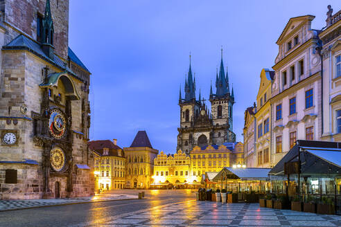 Czech Republic, Prague, Astronomical clock of Old Town Hall and Church of Our Lady before Tyn at dusk - YRF00228