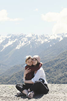 Mother hugging her son in the mountains, Sochi, Russia - EYAF00728