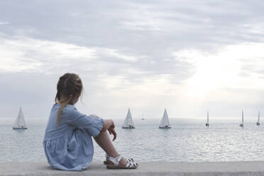 Lttle girl looking at the sea with boats - EYAF00734