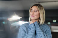 Portrait of a smiling young woman in a parking garage - DIGF09016