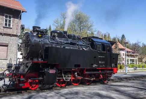Germany, Saxony-Anhalt, Quedlinburg, Steam locomotive waiting at railroad station - RUN03481