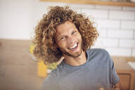 Portrait of happy young man at home - MCF00383