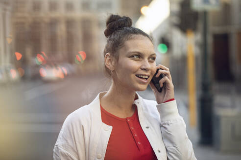 Young woman on the phone in the city - MCF00422
