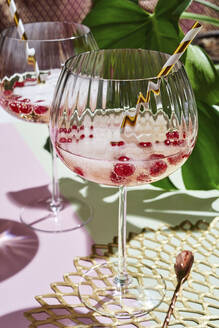 Glass of champagne with fresh berries - DREF00001