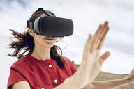 Mature woman wearing VR goggles - MCF00460