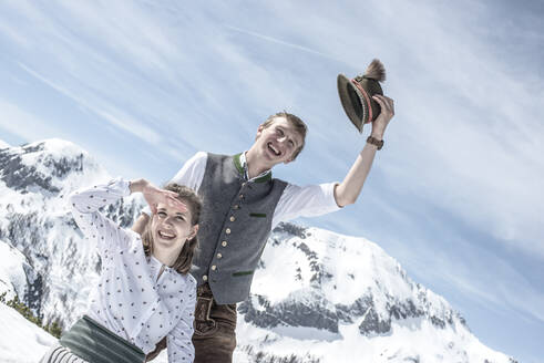 Happy couple in the snowy mountains, Salzburg State, Austria - HHF05590