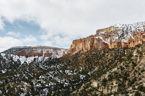 Low angle view of mountains against cloudy sky at Bryce Canyon National Park during winter - CAVF69803