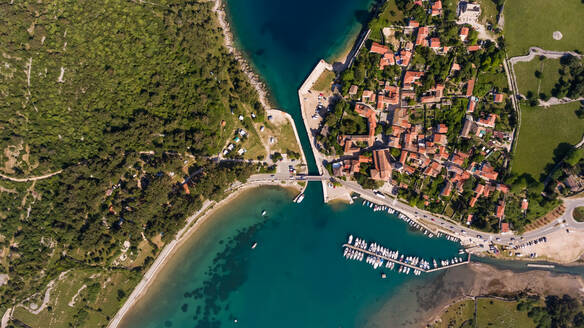 Aerial view of man-made canal crossing the city of Osor, Croatia. - AAEF05928