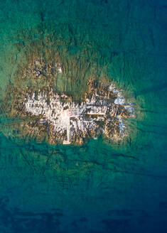 Aerial view of lighthouse at small island near Male Srakane, Croatia. - AAEF05982