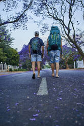 Two backpackers walking down a street - VEGF01017