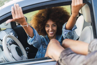 Young woman during road trip, sitting in car - AFVF04381