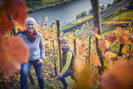 Portrait of two mature woman in a vineyard - FMKF06049