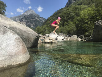 Woman's jump into refreshing mountain river water - GWF06332