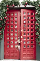 Portrait of siblings at doorway at Christmas time - EYAF00737