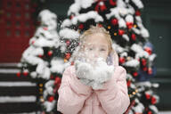 Little girl blowing snow - EYAF00740