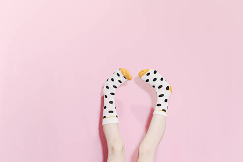 Legs of a girl wearing dotted socks - ERRF02291