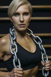 Blond sportswoman with chain at sport bars - MADF01438