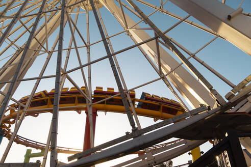 USA, California, Santa Monica, Low angle view of construction frame of Santa Monica Pier rollercoaster - SEEF00069