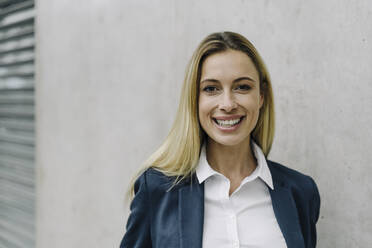 Portrait of a happy young businesswoman - JOSF03979