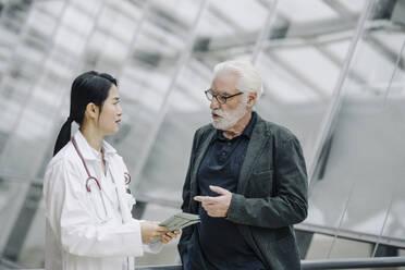 Female doctor talking to senior man - JOSF03985