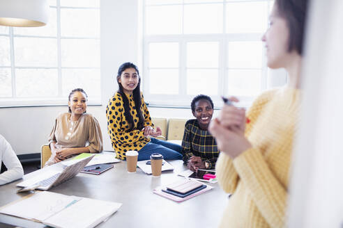 Businesswomen brainstorming in conference room meeting - HOXF04705