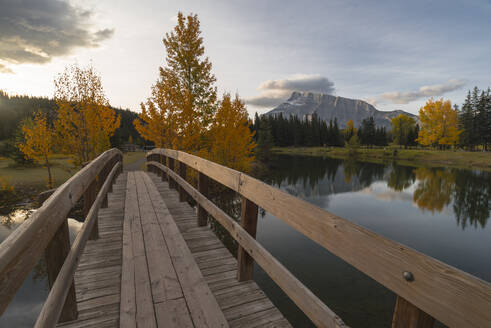 Bridge over Cascade Pond with Mount Rundle on horizon in autumn, Banff National Park, UNESCO World Heritage Site, Alberta, Rocky Mountains, Canada, North America - RHPLF13123
