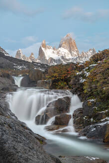 Secret waterfall and Fitz Roy at sunrise, El Chalten, Los Glaciares National Park, UNESCO World Heritage Site, Santa Cruz province, Argentina, South America - RHPLF13141
