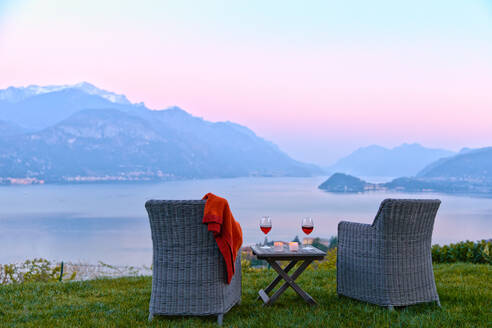 Armchairs and red wine with views of Lake Como at sunset, Lombardy, Italian Lakes, Italy, Europe - RHPLF13267
