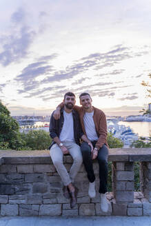 Portrait of gay couple on lookout above the city with view to the port, Barcelona, Spain - AFVF04415