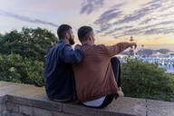 Gay couple on lookout above the city with view to the port, Barcelona, Spain - AFVF04418
