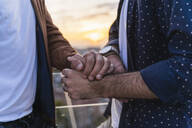 Close-up of gay couple holding hands - AFVF04430