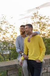 Happy gay couple outdoors at sunset - AFVF04442