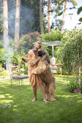 Woman playing with dog in garden - BFRF02157