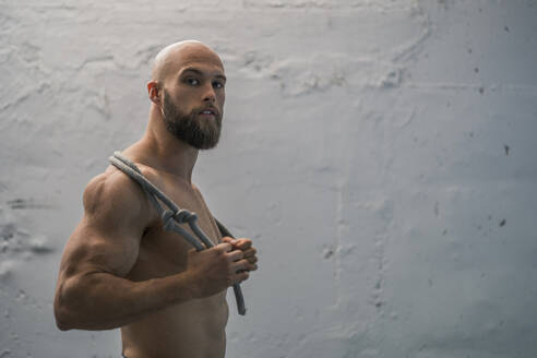 Portrait of a barechested athlete with rope - DLTSF00323